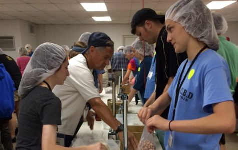 B-A student leading food packing event