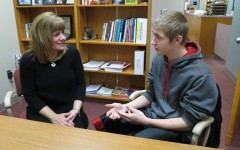 High School Assistant Principal talks with junior  Cole Kerns.  Mrs. Adams is a proponent of strong anti-bullying campaigns in schools.