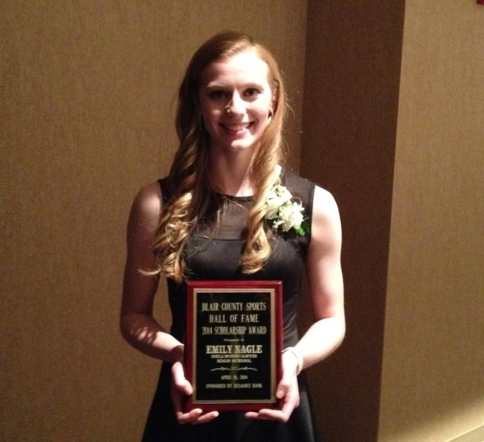 Emily Nagle with her scholarship plaque.