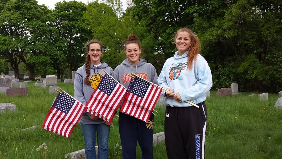 Meghan+Claar%2C+Kelly+Leamer+and+Selena+Damiano%2C+along+with+NHS+adviser+Sally+Padula%2C+recently+completed+community+service+by+placing+flags+on+the+graves+of+veterans+at+a+local+cemetery.
