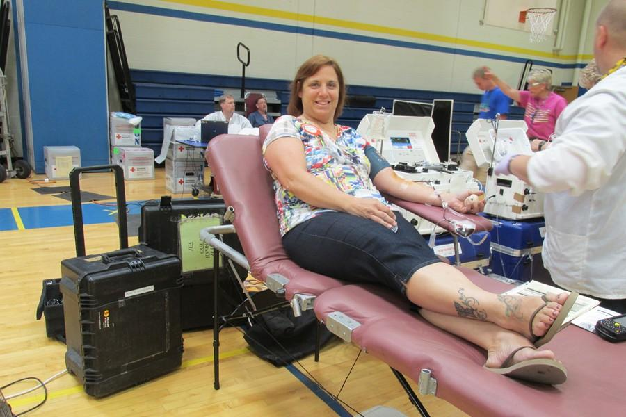 Students+and+faculty+are+encouraged+to+give+blood+at+the+Leo+Club+Blood+Drive%2C+like+attendance+secretary+Beth+Zitterbart+did+in+2014.