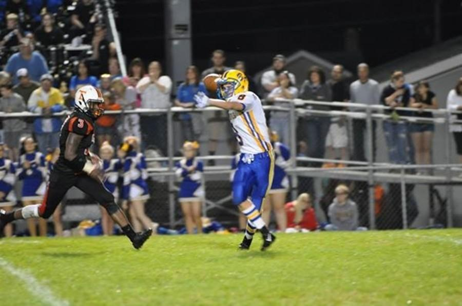 Jake+Burch+passed+for+150+yards+and+a+touchdown+in+the+Backyard+Brawl.