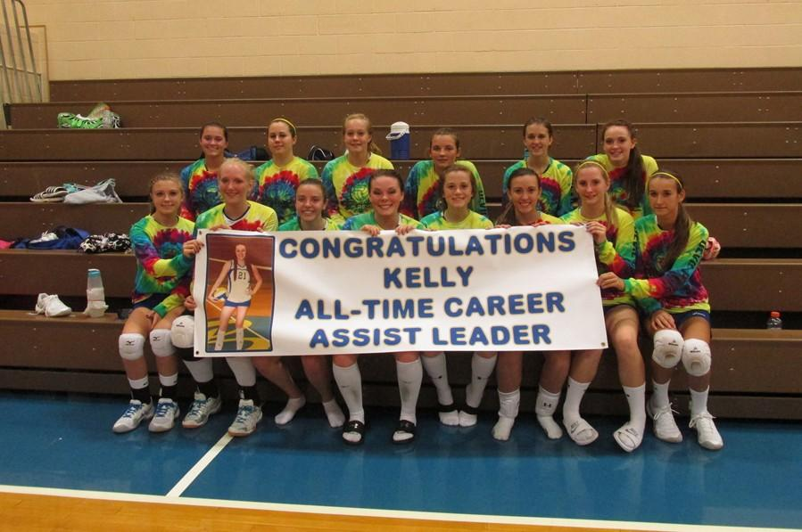 Kelly Leamer, center, celebrates with her teammates after getting her 1,000th assist last week against West Branch.