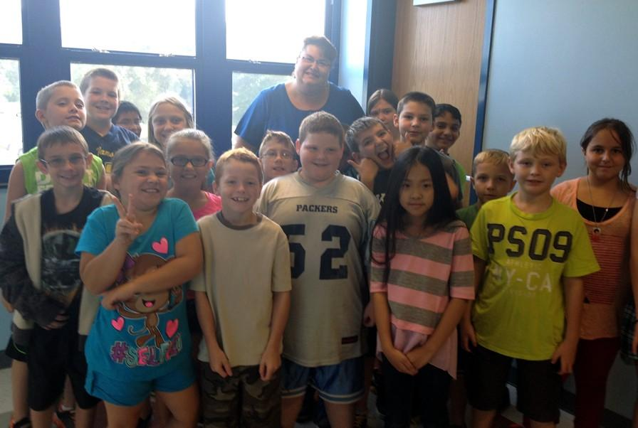 Mrs. Burns poses with her fourth grade students at Myers Elementary.