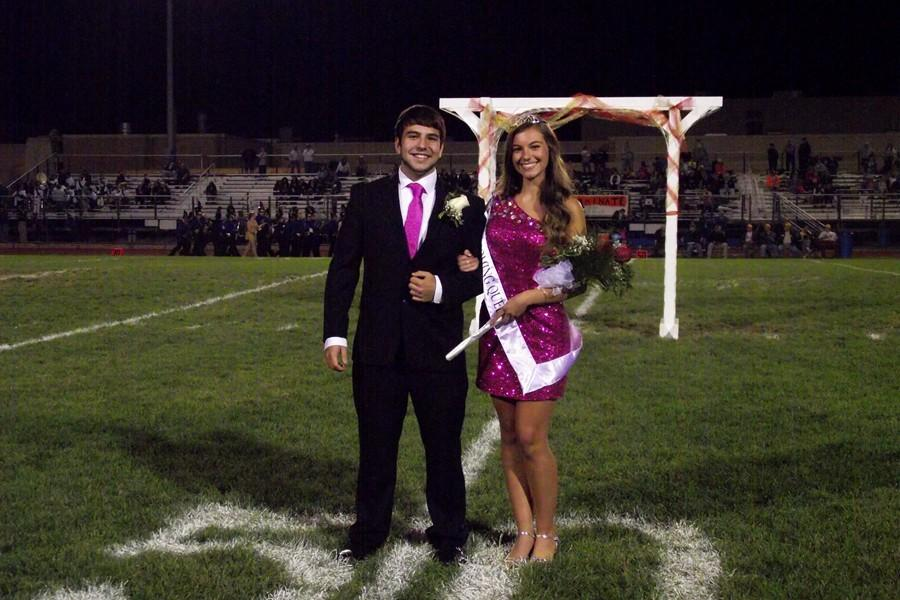 Paige Padula poses with escort Tyler Shultz after being crowned 2014 Homecoming queen.