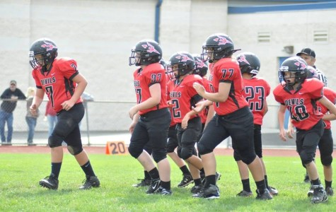 The North Side Red Devils  break the huddle in their game Sunday against Tyrone's Eagles.