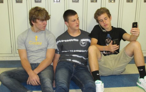 B-A juniors Codey Campbell (left) Nate Claar (middle) and Noah Burns (right) have different levels of cell phone dependency.