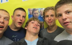 Library helpers Zach Mock, Nate Claar, Cody Campbell, Noah Burns and Jacob Hoover snap a selfie in front of the library's new selfie board.