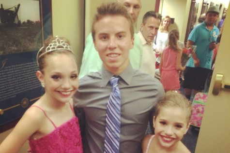 Ian is shown here with Maddie and McKenzie, two of the stars of the show Dance Moms.