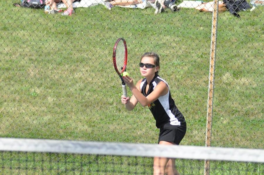 Tina Hollen is already one of the top tennis players on the varsity team, and she will be on the varsity basketball team this winter.