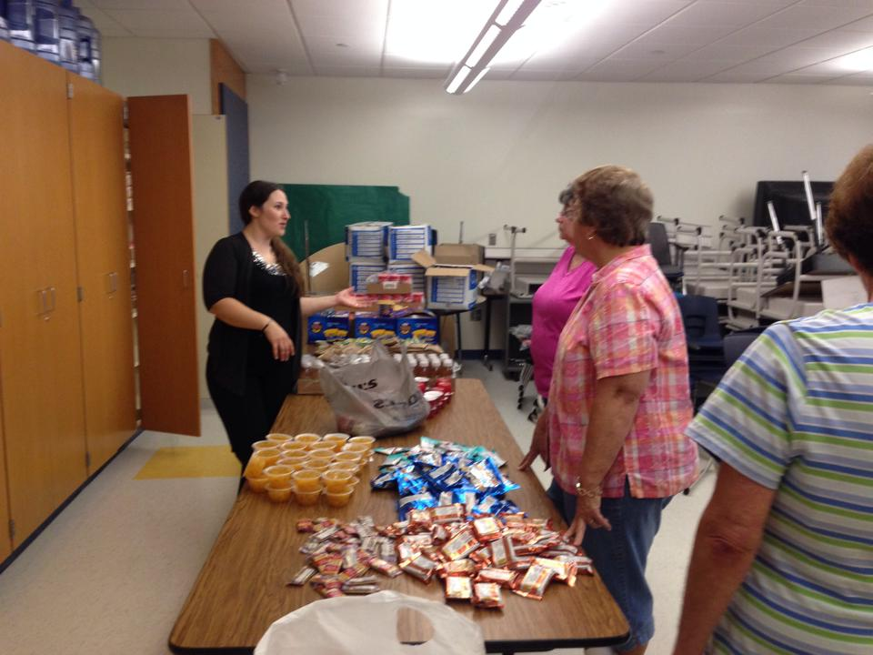 Parents have been a driving force behind the Blue Devil backpack program, with many volunteering time to fill the bags each week.