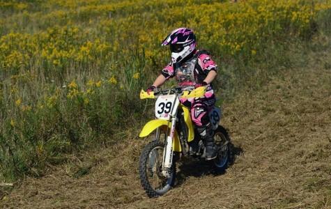 Freshman Kyra Woomer doing what she loves riding on her bike.