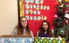 Middle school students Alexis Halvorsen and Paie Wenner take part in the Blue Angels project.