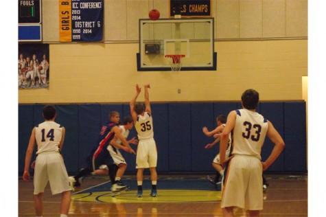 Davis shoots the ball up.