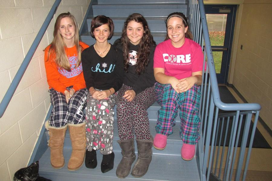 Alexis Parson, Carlee Gathagan, Kayla Beichler and Jaqueline Finn were among the students who wore pajamas to school Monday as part of Christmas Spirit week.