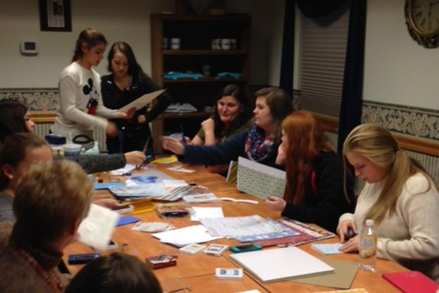 Rainbow girls from Bellwood-Antis making Christmas cards as part of a community service project.