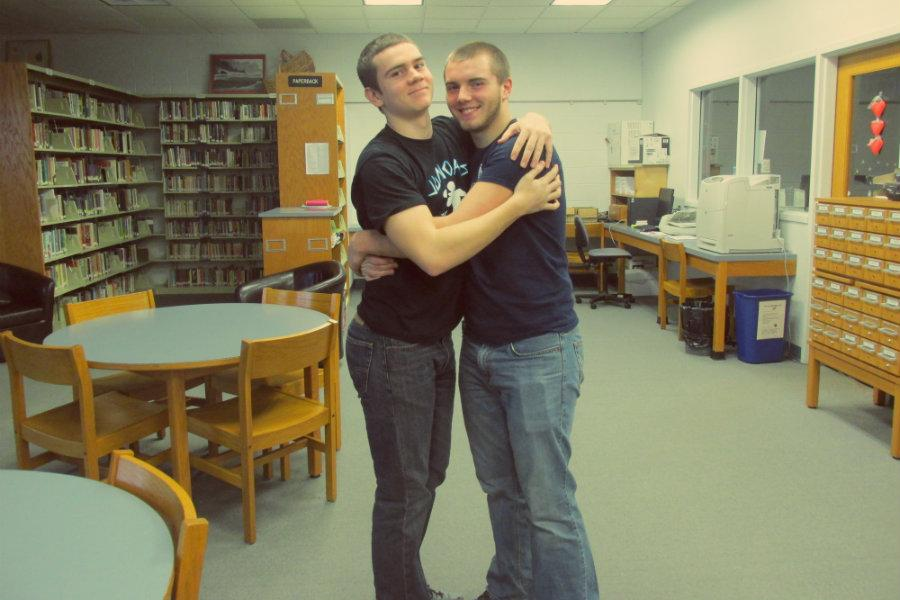 Jake McCaulley and Trenton Creppage hug it out in the library on National Hugging Day.