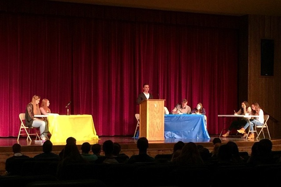 Senior Ian Schmoke takes the podium as the first speaker in his debate Monday at the annual CHS school-wide debates.