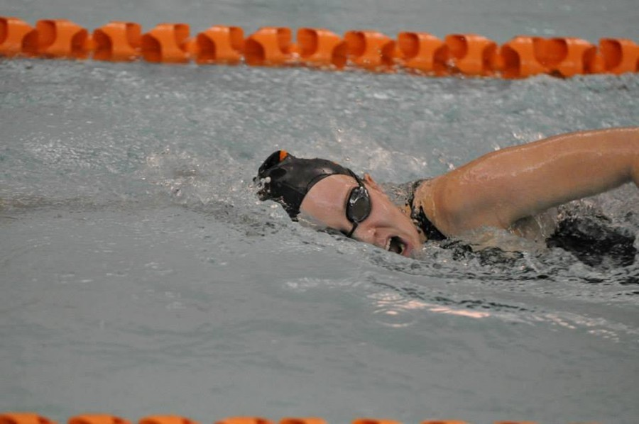 Anna Wolfe pushes hard in a relay race