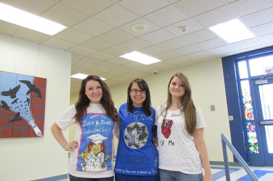 Seniors Rachel Harris, Emily Wagner and Jess Wertz were the winners in Thursdays Deign-Your-Own-Book-T-Shirt day as part of Read Across America Week.