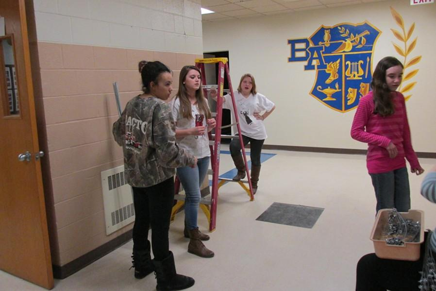 Dejah Rhodes, Jess Wertz and Michaela Miller were among a group of students Thursday preparing for Fridays Arts Night.