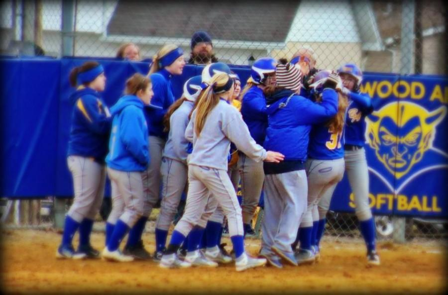 Somewhere in the pile at home plate in B-As No. 31 Jacqueline Finn, whose walk-off grand slam sent the Lady Devils past Northern Bedford 8-4 in 8 innings last Friday
