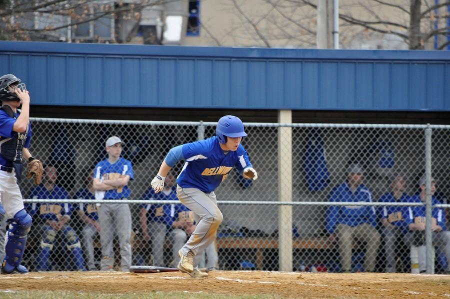 Zach Mock running to first base