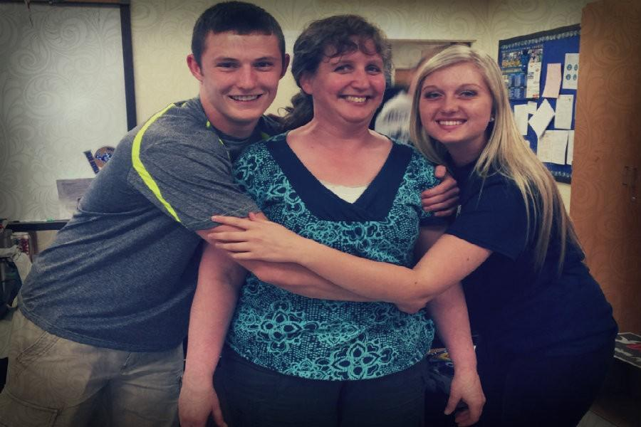 Cameron Wood and Natalie Dumin show physics teacher Alice Flarend some love during Teacher Appreciation Week.
