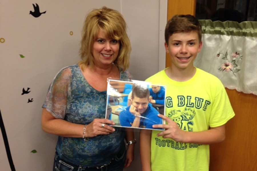 Karen Miller can see middle-schooler Trevor as she works in the guidance office, was well as senior Tyson.