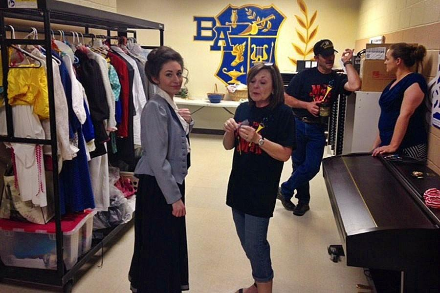Amanda Albright, Madame Librarian herself, prepares backstage with Amy Misera at a dress rehearsal for The Music Man.