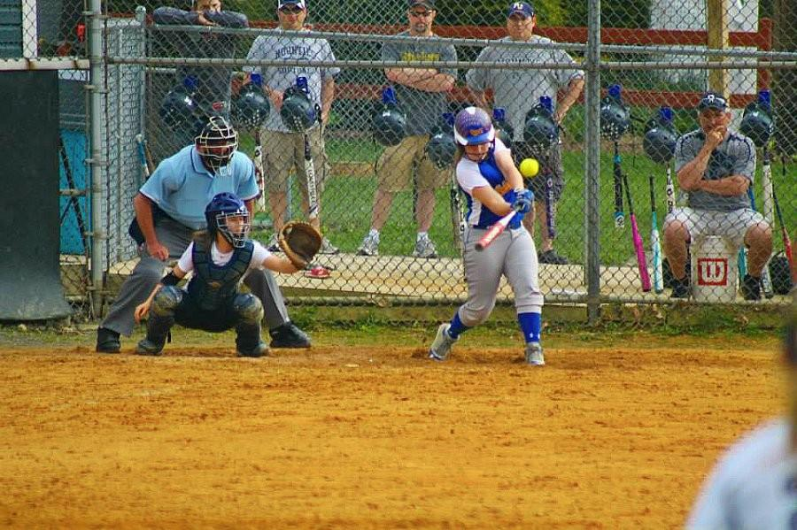 Jacqueline Finn blasts as home run yesterday against P-O. The Lady Mounties won 5-3.
