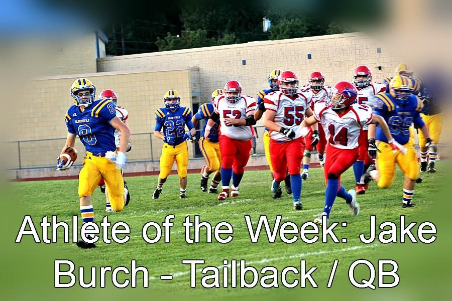 Jake+Burch+running+for+one+out+of+five+touchdowns+last+Friday.