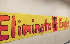 This banner hangs on the wall to motivate the team for the big game