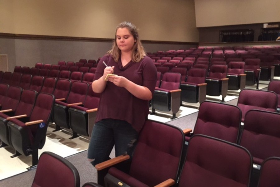 Leo Club members like Makala Doyle and Mariah Younker, shown above setting up the auditorium, are taking Skit Night in a new direction this year.