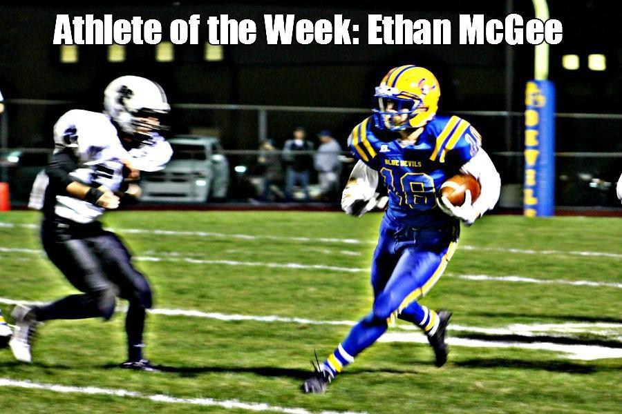 Junior+Ethan+McGee+running+the+ball.