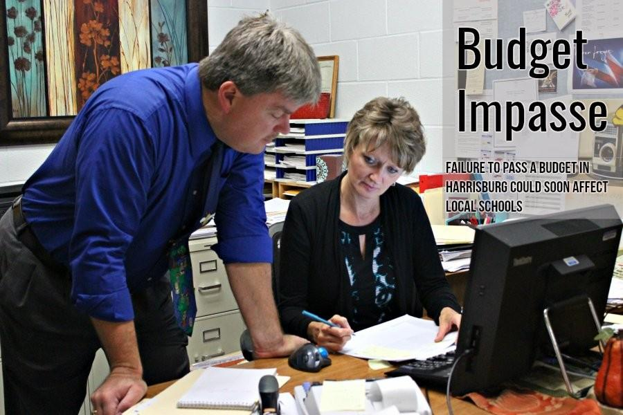 Superintendent Dr. Thomas McInroy and business manager Kim Van Gorder look over budget figures. McInroy said BASD has been able to avoid taking out loans to pay the bills as a result of a state budget stalemate.