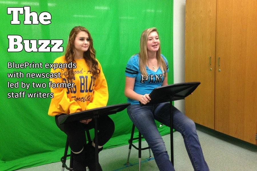 Emilee+Astore+and+Edyn+Convery+doing+their+weekly+newscast.