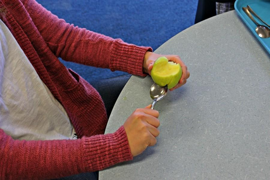 One freshman hacks apart an apple just to pass the time.