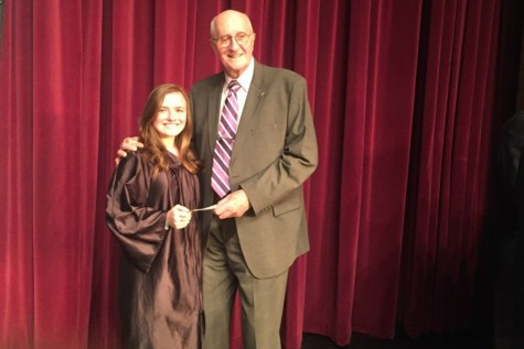 Cassidee Reiter receives her award check from Donald Mills of the B-A Lions Club. Cassidee won the club's Veterans Day writing contest with her poem about PTSD.
