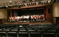 The vocalists practice for the concert on Tuesday.