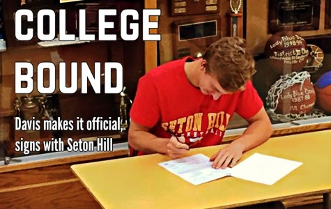 Senior hoops star Nathan Davis signed his National Letter of Intent yesterday to play for Seton Hill.
