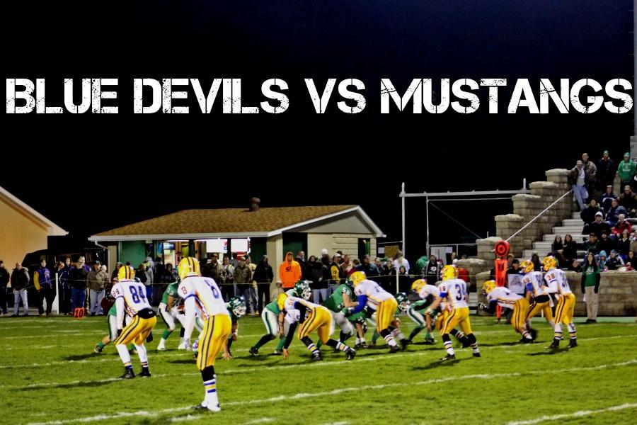 The+B-A+defense+tries+to+stop+the+Mustangs.