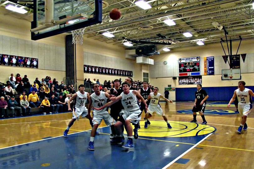 The boys basketball team looks for the rebound.