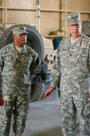 Comanche Garcia listen intently to General Wesley Craig during a visit to Kuwait.