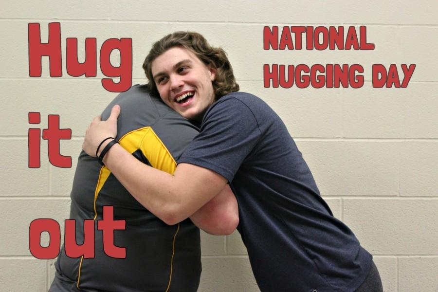 Ethan McGee and Jason Shade opt for the classic embrace on National Hugging Day.