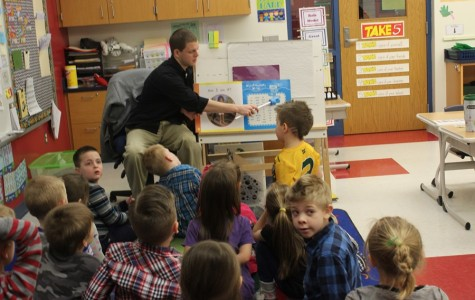 Mr. Koleno works on learning days of the month with kindergarten students at Myers.