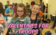 Students packing snacks for troops in the Middle East.