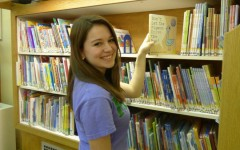 Abby Bouslough is part of a new reading initiative through the University of Pittsburgh to provide books for youngsters.
