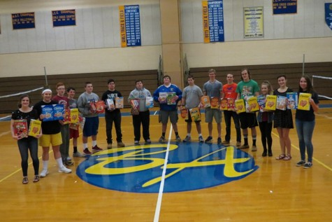 FCA members holding the donated cereal.