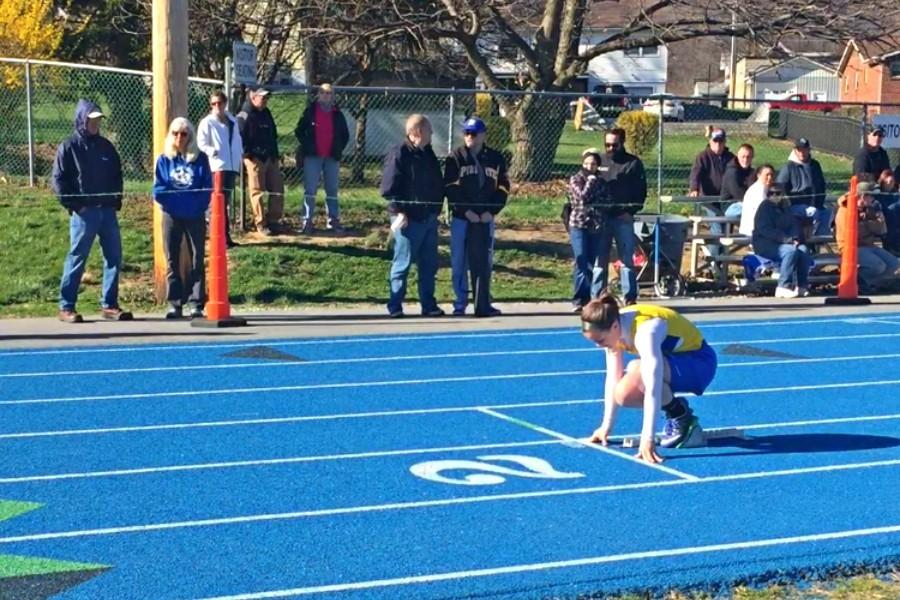 The girls and boys track and field teams lost Tuesday at Bedford, but senior Marissa Panasiti was a bright sport with two individual victories,